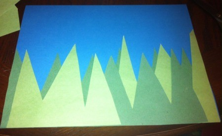 Spring Day Project Using Stickers - cut tall grass blades from both shades of paper and glue to blue piece