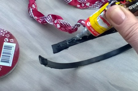 Revamp an Old Headband with Ribbon - apply glue along the band