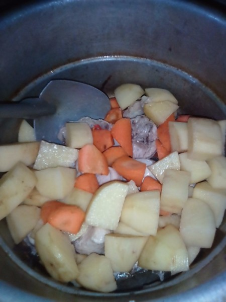 added potatoes and carrots to chicken in pan