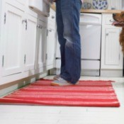 Throw rug on a kitchen floor.