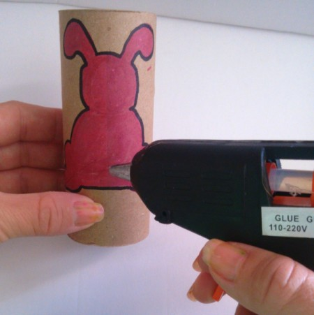 Toilet Paper Tube Easter Bunnies - adding a dot of hot glue to bunny bottom