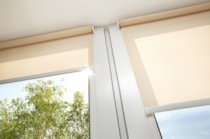 Cream colored roller blinds.