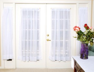 French doors with sheer window curtains.