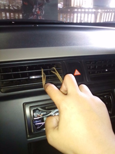 A rubber band in a vent, for holding a cellphone.