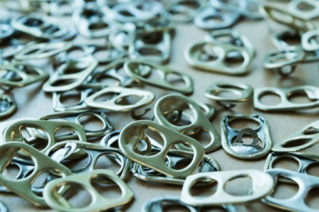 A pile of silver soda can tabs.
