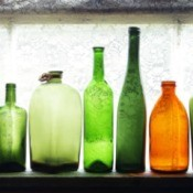 A row of old glass bottles.