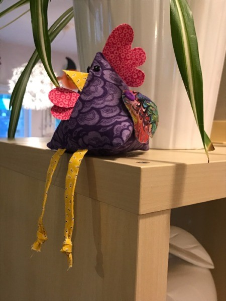 Fabric Chicken Doorstop - sitting on top of room divider