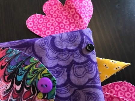 Fabric Chicken Doorstop - closeup of eye