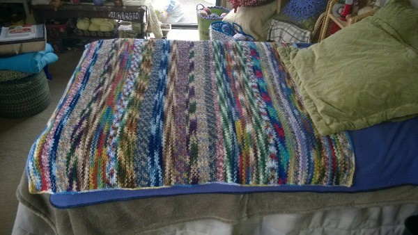 Recycled Yarn Afghan - side view of day bed with afghan