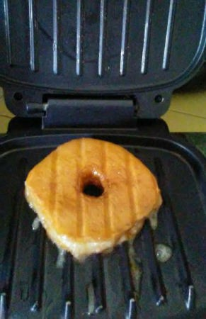 A freshly grilled glazed doughnut.