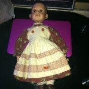 Identifying a Porcelain Doll - doll without wig in white and striped dress
