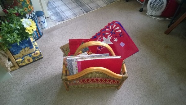 A magazine rack with greeting cards stored inside.