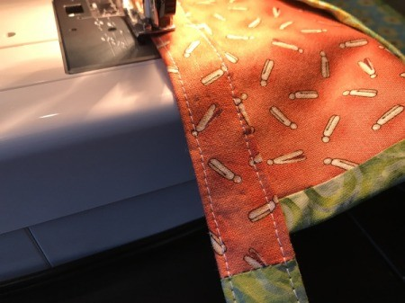 Clothespin Apron - topstitching across the waistband