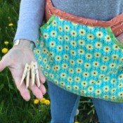 Clothespin Apron - person wearing the apron and holding a couple of clothes pins