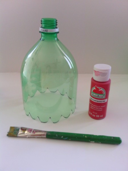 Soda Bottle Bird Feeder - top with a bottle of red paint and a brush