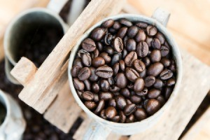 A cup of fresh coffee beans.