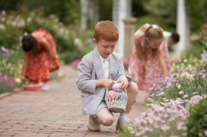 Children hunting for eggs after church on Easter.