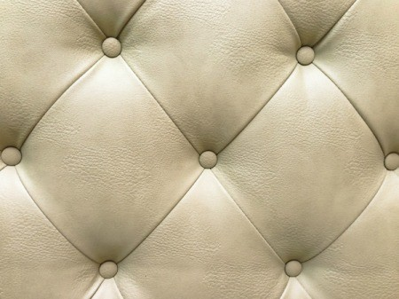 Upholstered cream leather sofa.