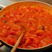 A pan of tomato sauce for spaghetti.