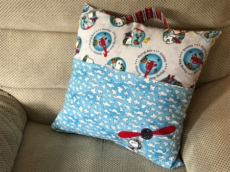 Book Pocket Pillow - finished pillow on chair