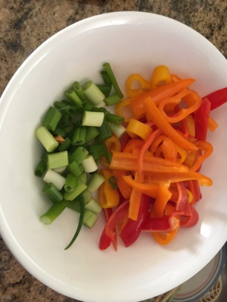 peppers and green onions chopped