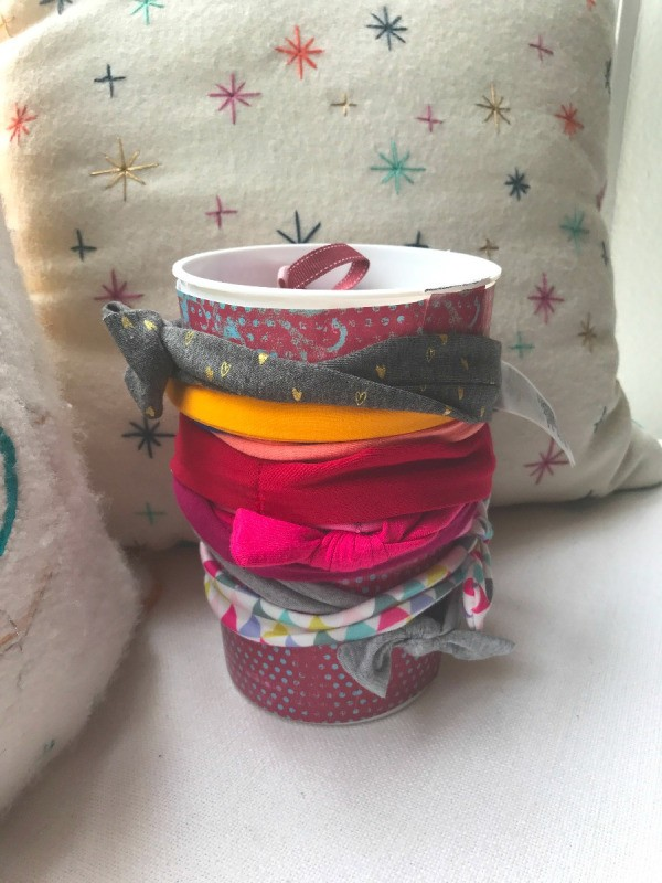 Repurposing Yogurt Container for Bow/Headband Storage - headbands wrapped around contains