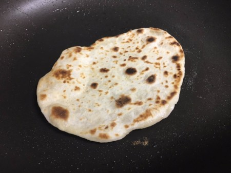 flatbread flipped in pan