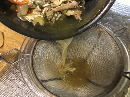 straining Chicken Stock
