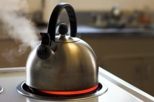 Tea Kettle Boiling on Stove