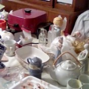 Items in a home prepared for an indoor yard sale.