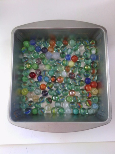 How to Make Crystallized Marbles - put marbles in the metal pan
