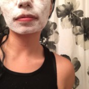 Baby powder all over a woman's face.