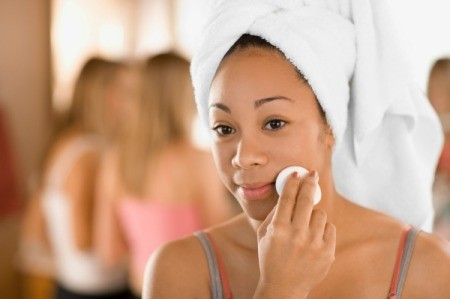 Girl applying Witch Hazel Toner to her face