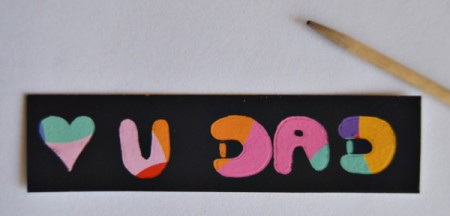 Love U Dad Card - Use the pencil to write a message on the piece cut from the scratch art paper board.