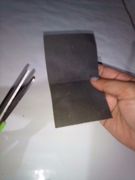 A piece of folded sandpaper.