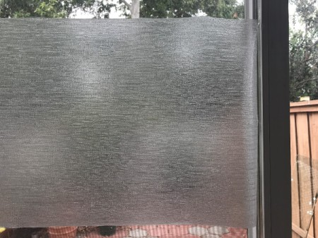A window covered with a privacy window film.