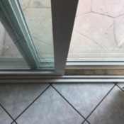 Secure Your Sliding Door and Windows - length of wood inside the sliding door track