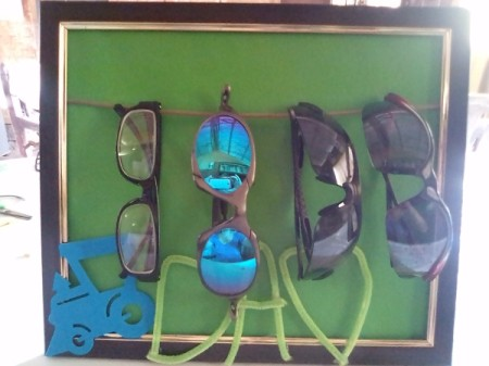 Frame of Shades for Father's Day - four pairs of glasses hanging