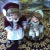 Value of Seymour Mann Dolls - girl and boy doll sitting on a bench