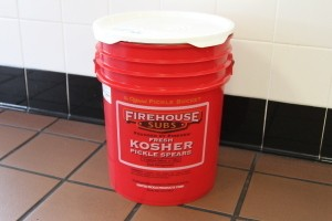 A 5 gallon bucket from Firehouse Subs, for use in gifting.