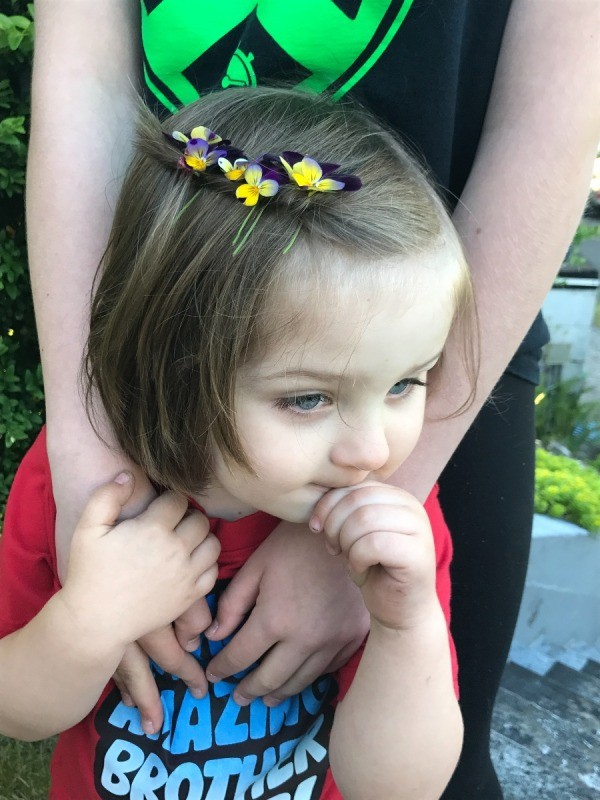 Toddler Fun With Flowers - little boy with flowers in his hair