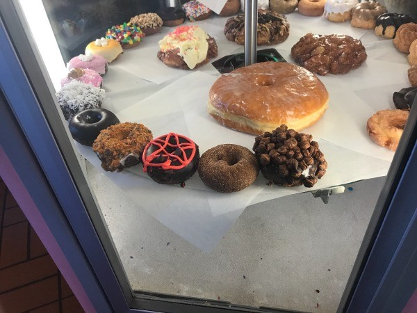 Visting Voodoo Doughnuts (Portland, OR) - display of donuts