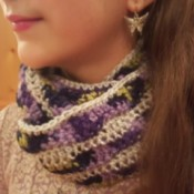 A crocheted cowl infinity scarf with a wave pattern.