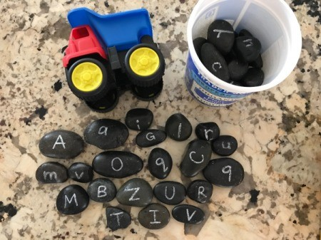 Alphabet Rocks - truck on side and scatter of rocks