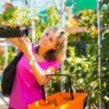 Woman Buying Plants at Garden Store