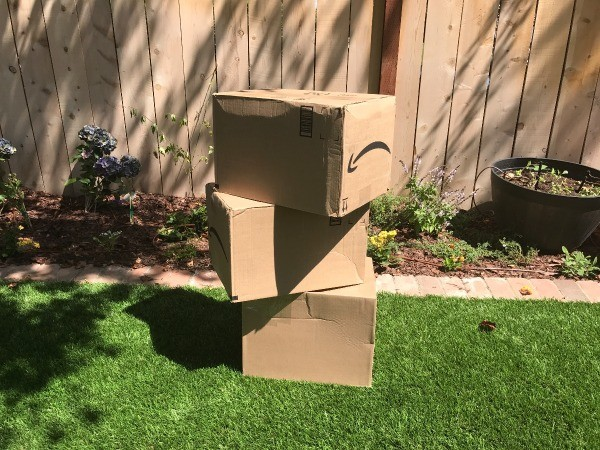 Reusing Cardboard Boxes as Outdoor Blocks - stack of Amazon shipping boxes