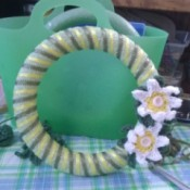Crochet Daisy Wreath - green ribbon added and daisies glued on