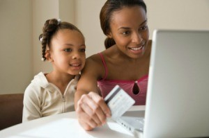 A mother and daughter shopping online.