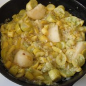 Chunks of potato added to cooked squash.