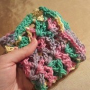 A multicolored crocheted dishcloth.